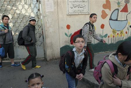 Schoolchildren leave school early, after residents said they saw groups of Hezbollah men deployed in the street in Beirut January 18, 2011. Lebanese security forces deployed in central Beirut on Tuesday and several schools closed in response to tensions surrounding a draft indictment issued over the 2005 killing of former premier Rafik al-Hariri. REUTERS/Mahmoud Tawil