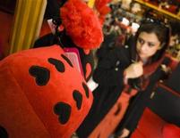 <p>An Iranian woman looks for Valentine's day gifts in Tehran February 14, 2010. REUTERS/Morteza Nikoubazl</p>