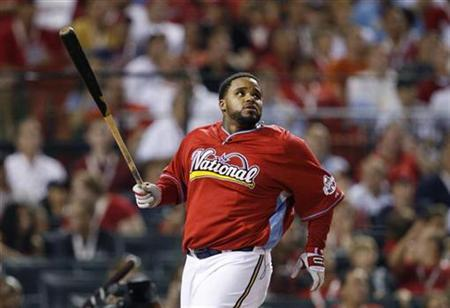 Milwaukee Brewers' Prince Fielder of the National League watches the flight of a ball in Major League Baseball's annual Home Run Derby during All-Star game festivities in St. Louis July 13, 2009. REUTERS/Jeff Haynes