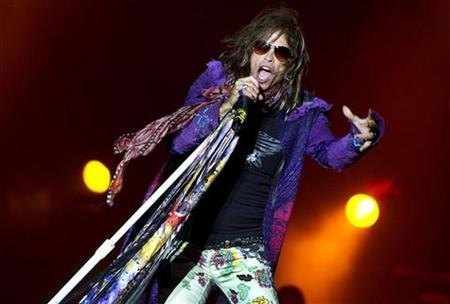Singer Steven Tyler of the U.S. rock band Aerosmith performs at the Sweden Rock Festival in Solvesborg June 10, 2010. REUTERS/Claudio Bresciani/SCANPIX