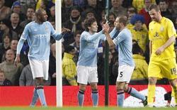 """<p>Игроки """"Манчестер Сити"""" радуются голу, забитому в ворота """"Лестера"""", в Манчестере 18 января 2011 года. """"Манчестер Сити"""" оказался сильнее представителя второго английского дивизиона """"Лестера"""" в ответном матче 1/32 финала Кубка Англии. REUTERS/Darren Staples</p>"""