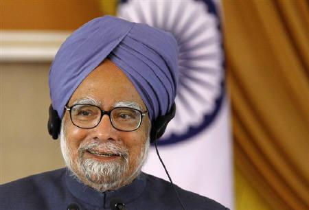 Prime Minister Manmohan Singh in New Delhi December 21, 2010. Singh tweaked his cabinet line-up on Wednesday, sparking criticism the government was shying away from battling graft scandals and high inflation, and dimming prospects for major economic reforms soon. REUTERS/B Mathur/Files
