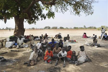 Newly arrived southern Sudanese returnees from Darfur are photographed shortly after being dropped off from a bus in Wanjok, near Aweil in Northern Bhar El-Ghazal January 16, 2011. REUTERS/Paul Banks/UNMIS/Handout