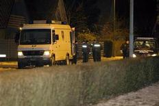 <p>Police vehicles are seen outside Danish cartoonist Kurt Westergaard's home in eastern Juttland, Denmark January 1, 2010. A Somali man armed with an axe and suspected of links with al Qaeda broke into the home of Westergaard whose drawings of the Prophet Mohammad caused global Muslim outrage and was shot and wounded by police. REUTERS/Brian Rasmussen/Scanpix</p>