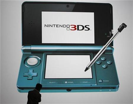 A man looks at a billboard of Nintendo Co Ltd's new 3DS handheld game console in Chiba, east of Tokyo September 29, 2010. REUTERS/Toru Hanai