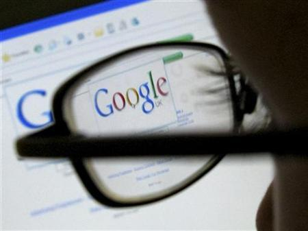 A Google search page is seen through the spectacles of a computer user in Leicester, July 20, 2007. REUTERS/Darren Staples