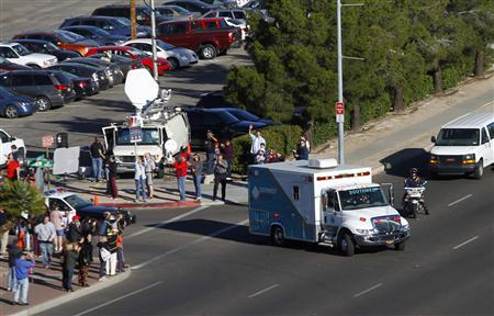 The medical ambulance transporting U.S. Congresswoman Gabrielle Giffords leaves the University Medical Center en-route to Davis-Monthan Air Force Base in Tucson, Arizona January 21, 2011. REUTERS/Joshua Lott