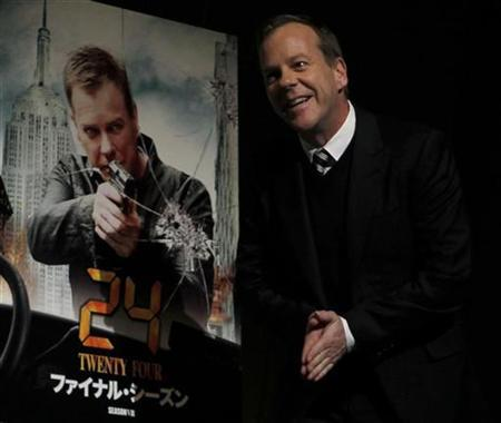 Cast member of ''24'' Kiefer Sutherland greets fans and the media during a promotional event in Tokyo November 16, 2010. REUTERS/Toru Hanai