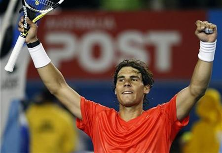 Rafael Nadal of Spain celebrates victory over Marin Cilic of Croatia at the Australian Open tennis tournament in Melbourne January 24, 2011. REUTERS/Tim Wimborne
