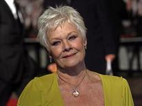 """<p>Actress Judi Dench poses as she arrives for the world premiere of the film """"Nine"""" at Leicester Square in London December 3, 2009. REUTERS/Stefan Wermuth</p>"""