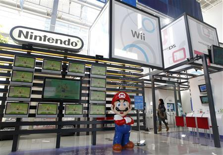 A woman walks at Nintendo Co Ltd's showroom in Tokyo January 27, 2011. Nintendo Co Ltd reported a 46 percent fall in quarterly profit, as sales of its ageing DS handheld device tumbled ahead of the launch of a new, 3D-capable model next month. REUTERS/Kim Kyung-Hoon
