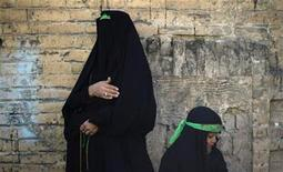 <p>A woman and her daughter wear green headbands, symbols of the Imam Hussein family, during a Shi'ite Ashura religious festival in Khorramabad, 491 km (305 miles) southwest of Tehran, December 15, 2010. REUTERS/Morteza Nikoubazl</p>