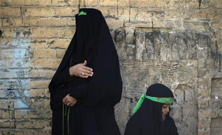 A woman and her daughter wear green headbands, symbols of the Imam Hussein family, during a Shi'ite Ashura religious festival in Khorramabad, 491 km (305 miles) southwest of Tehran, December 15, 2010. REUTERS/Morteza Nikoubazl