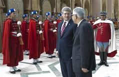 <p>Canada's Prime Minister Stephen Harper reviews an honour guard with Morocco's Prime Minister Abbas El Fassi (2nd R) at the royal palace in Agadir January 27, 2011. REUTERS/Adrian Wyld/Pool</p>