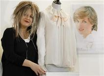 <p>Designer Elizabeth Emanuel poses with her creation,a chiffon blouse worn by Lady Diana Spencer for her engagement portrait (R) by Lord Snowdon, pictured at La Galleria in London June 7, 2010. REUTERS/Luke MacGregor</p>