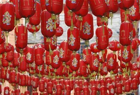 Chinese lanterns hang above the streets in London's Chinatown district to celebrate the Chinese New Year January 26, 2009. REUTERS/Stephen Hird
