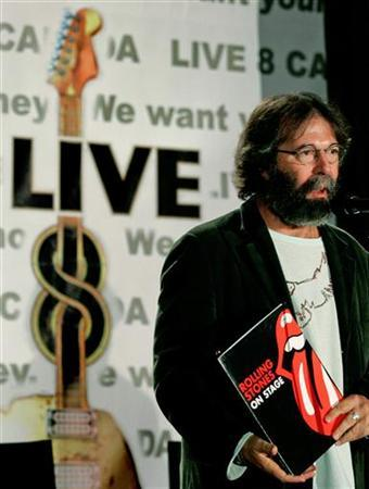 Live 8 Producer Michael Cohl holds up a Rolling Stones folder at the start of a news conference announcing details of the Canadian Live 8 concert in Toronto, in this June 21, 2005 file photo. The Rolling Stones' next tour has not even been announced yet, but it is playing a key role in a legal battle between Cohl who has organized their treks for two decades and concert promoter Live Nation. REUTERS/J.P. Moczulski