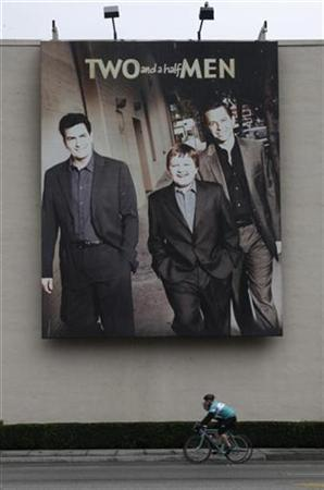 A poster promoting actor Charlie Sheen's hit comedy series 'Two and A Half Men' is shown at Warner Bros. Studios in Burbank, California January 30, 2011. REUTERS/Fred Prouser