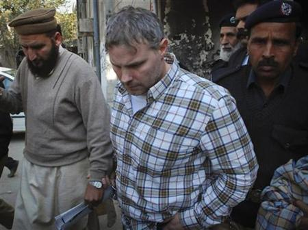 Raymond Davis is escorted by police and officials out of court after facing a judge in Lahore, January 28, 2011. REUTERS/Tariq Saeed