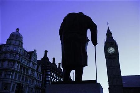 The Big Ben clock and a statue of former British Prime Minister Winston Churchill are silhouetted against the morning sky in central London, January 1, 2010. REUTERS/Eddie Keogh