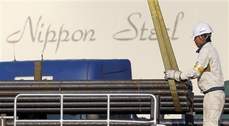 A worker loads steel products on a truck at Nippon Steel Corp's collection facility in Tokyo February 4, 2011. Plans by Nippon Steel Corp and Sumitomo Metal Industries to create the world's No. 2 steelmaker fanned expectations of further consolidation in the fragmented industry, sending Japanese steelmakers shares surging on Friday. REUTERS/Kim Kyung-Hoon