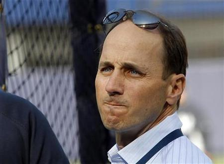 New York Yankees General Manager Brian Cashman looks on during Yankees batting practice before their MLB American League baseball game against the Chicago White Sox in New York, April 30, 2010. REUTERS/Mike Segar