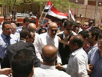 <p>Mohamed ElBaradei (C), former head of the U.N. nuclear agency, is welcomed by supporters during a rally in Fayoum, about 100 km (62 miles) south of Cairo, June 4, 2010. REUTERS/Asmaa Waguih</p>