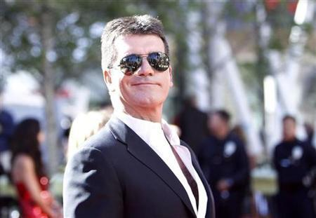 Judge Simon Cowell arrives for the 9th season finale of 'American Idol' in Los Angeles May 26, 2010. REUTERS/Mario Anzuoni