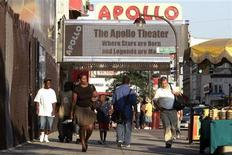 <p>Pedestrians make their way along 125th Street near the Apollo Theater in the Harlem neighborhood of New York August 9, 2006. REUTERS/Keith Bedford</p>