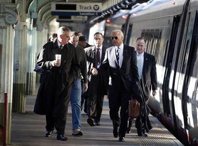 Vice President Joseph Biden and Secretary of Transportation Ray LaHood walk next to an Amtrak train at Union Station in Washington, February 8, 2011. REUTERS/Larry Downing