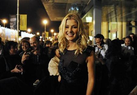 British actress Rosamund Pike leaves the Victoria Eugenia theatre after the screening of the film ''Barney's Version'' on the eighth day of the 58th San Sebastian Film Festival September 24, 2010. REUTERS/Vincent West