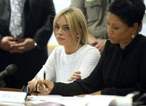 <p>Actress Lindsay Lohan (L) and her attorney Shawn Chapman Holley appear in court as she pleads not guilty to a grand theft charge of stealing a $2,500 necklace from a jewelry store, in Los Angeles February 9, 2011. REUTERS/Mario Anzuoni</p>