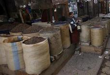 <p>A raisin vendor chews Qat, a green leaf which acts as a mild stimulant, as he sits at his stall in the Old Sanaa city January 19, 2011. REUTERS/Khaled Abdullah</p>