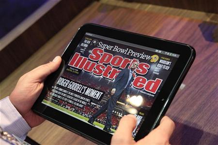 A digital edition of Sports Illustrated is shown on the new HP Palm TouchPad after a media presentation on the company's web OS at the Herbst Pavilion at the Fort Mason Center in San Francisco February 9, 2011. REUTERS/Beck Diefenbach (UNITED STATES - Tags: SCI TECH BUSINESS)