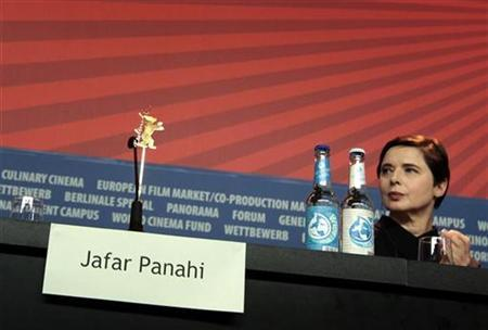 The empty chair of Iranian director Jafar Panahi is seen beside jury president and actress Isabella Rossellini during a news conference of the Jury at the 61st Berlinale International Film Festival in Berlin February 10, 2011. REUTERS/Christian Charisius (