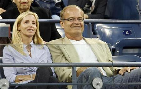 Actor Kelsey Grammer (R) and wife Camille watch a match at the U.S. Open tennis tournament in Flushing Meadows, New York August 27, 2008. REUTERS/Jeff Haynes