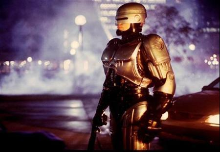 Actor Richard Eden , dressed as Robocop stands on the set of the new television series in Toronto on Oct. 11, 1993. REUTERS/STR New