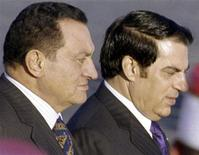 <p>Egyptian President Hosni Mubarak (L) is escorted by Tunisian President Zine al-Abidine Ben Ali upon his arrival in Tunis in this October 30, 2002 file photo. REUTERS/Mohamed Hammi/Files</p>