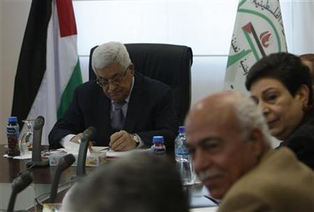 Palestinian President Mahmoud Abbas (C) attends a Palestinian Liberation Organization (PLO) executive committee meeting in the West Bank city of Ramallah February 12, 2011. REUTERS/Mohamad Torokman
