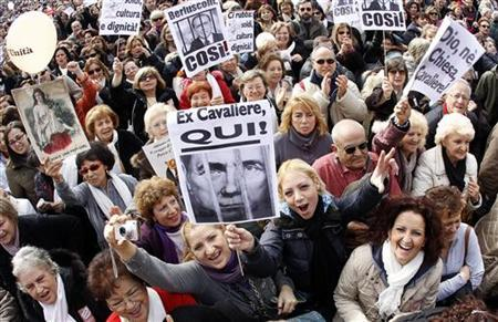Protesters gather in Rome's Piazza del Popolo to demonstrate against Italian Prime Minister Silvio Berlusconi February 13, 2011. REUTERS/Alessandro Bianchi