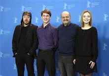 <p>Director Alexander Mindadze (2nd R) poses with cast members Svetlana Smirnova-Marcinkevich (R) Anton Shagin and Stanislav Rjadinsky (L) during a photocall to promote the movie 'V Subbotu' (Innocent Saturday) at the 61st Berlinale International Film Festival in Berlin February 14, 2011. REUTERS/Christian Charisius</p>
