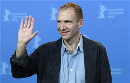 Actor and director Ralph Fiennes waves as he poses during a photocall to promote the movie 'Coriolanus' at the 61st Berlinale International Film Festival in Berlin February 14, 2011. REUTERS/Christian Charisius
