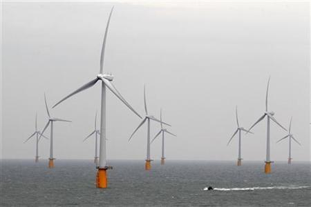 A boat powers past the Thanet Offshore Wind Farm off the Kent coast in southern England September 23, 2010. Thanet farm is the world's largest operational offshore wind farm. REUTERS/Stefan Wermuth