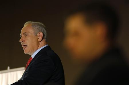 Israel's Prime Minister Benjamin Netanyahu (L) speaks during the Conference Of Presidents of Major American Jewish Organizations in Jerusalem February 16, 2011. Israel said on Wednesday it had alerted ''friendly nations'' in the Middle East about two Iranian warships planning to pass through Egypt's Suez Canal for Syria. REUTERS/Baz Ratner