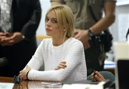 Actress Lindsay Lohan appears in court as she pleads not guilty to a grand theft charge of stealing a $2,500 necklace from a jewelry store, in Los Angeles February 9, 2011. REUTERS/Mario Anzuoni