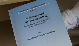 <p>A copy of the dissertation of German Defence Minister Karl-Theodor zu Guttenberg is displayed by staff of Berlin's Humboldt university jurisprudence library February 16, 2011. German media reported February 16, 2011, that law professor Andreas Fischer-Lescano has accused German Defence Minister Karl-Theodor zu Guttenberg of plagiarising parts of his dissertation from various authors, for his doctorate of law. Fischer-Lescano said that Guttenbergs dissertation contains several parts of foreign text that are not referenced. REUTERS/Fabrizio Bensch (GERMANY - Tags: POLITICS)</p>