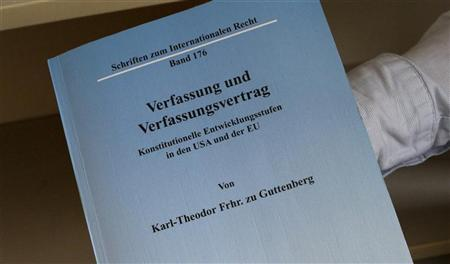 A copy of the dissertation of German Defence Minister Karl-Theodor zu Guttenberg is displayed by staff of Berlin's Humboldt university jurisprudence library February 16, 2011. German media reported February 16, 2011, that law professor Andreas Fischer-Lescano has accused German Defence Minister Karl-Theodor zu Guttenberg of plagiarising parts of his dissertation from various authors, for his doctorate of law. Fischer-Lescano said that Guttenbergs dissertation contains several parts of foreign text that are not referenced. REUTERS/Fabrizio Bensch (GERMANY - Tags: POLITICS)