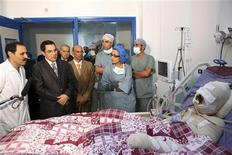 <p>Tunisian President Zine El-Abidine Ben Ali (2nd L) visits Mohamed Al Bouazzizi (R), the protester who set himself alight during a demonstration against unemployment, at a hospital in Ben Arous near Tunis, December 28, 2010. Bouazizi, a vegetable seller, set himself alight on December 17 and died on January 5, 2011, igniting nationwide protests that forced ex-president Zine al-Abdine Ben Ali to flee the country. REUTERS/Tunisian Presidency/Handout</p>