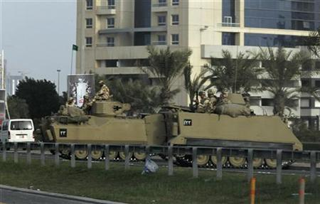 Military tanks are seen on the road to the Pearl Roundabout in Manama February 17, 2011. REUTERS/Hamad I Mohammed