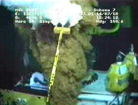 Work continues on equipment at the site of the BP oil well leak in the Gulf of Mexico, in this image captured from a BP live video feed July 14, 2010. REUTERS/BP/Handout